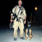 Senior Chief Petty Officer James Hatch (left) and Military canine Remco
